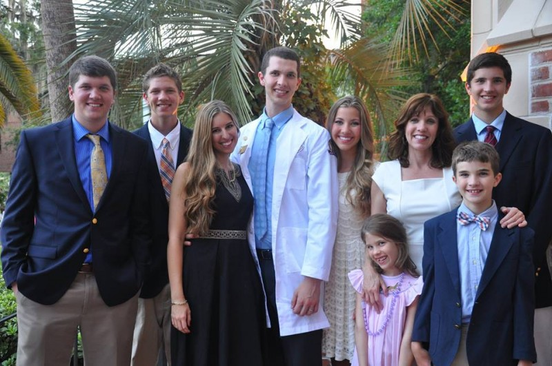 Lisa and her family celebrating with her oldest son at his White Coat Ceremony.