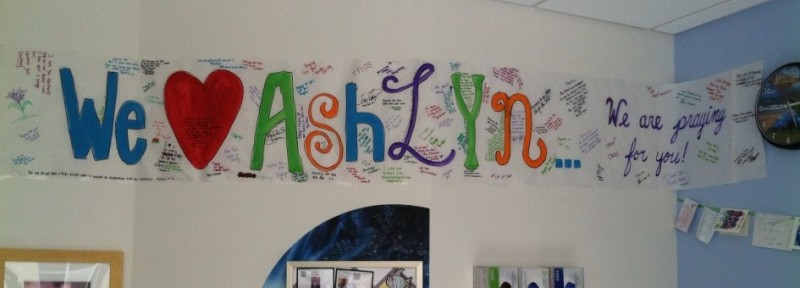 Banner in hospital room, signed by Ashlyn's friends and (forged) celebrities.