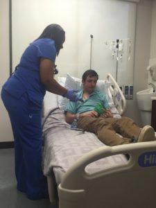 Nurse accesses port for chemo